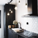 skona hem kitchen subway tile plank covered cabinets light bulb pendants cococozy