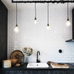 skona hem kitchen subway tile plank covered cabinets light bulb pendants lights textile cords wrapped around pole cococozy