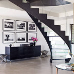 Nikako novi koncept, moderna elegancijaartment foyer entry hall glass stairs staircase framed prints gallery wall gray cement floors cococozy modern design